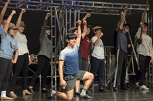Bellarmine's cast of Newsies in rehearsals